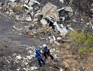 26FB1DFF00000578-3010610-Obliterated_Search_and_rescue_teams_sift_through_the_wreckage_of-a-2_1427318127069