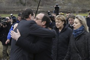 26FB46AE00000578-3010610-Show_of_solidarity_French_President_Francois_Hollande_centre_emb-a-7_1427318128076