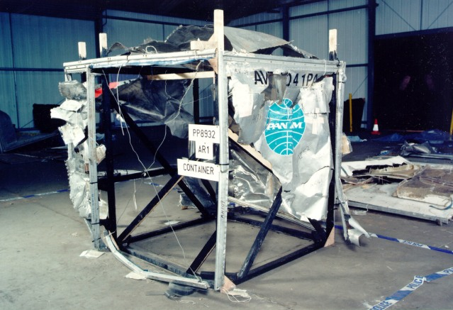 A BAGGAGE CONTAINER IS SHOWN WITH DAMAGE FROM THE LOCKERBIE BOMB.